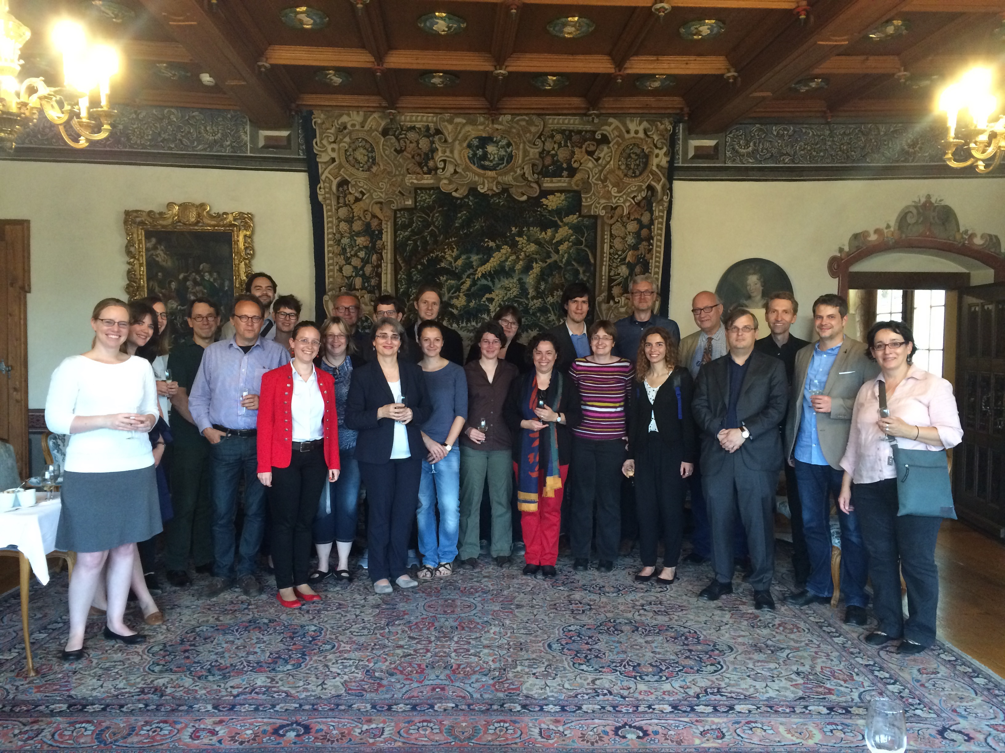 Group photograph of the conference participants at dinner